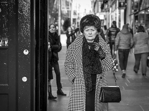 © Leanne Boulton, All Rights Reserved Candid eye contact street photography from Glasgow, Scotland. Finely dressed and showing great pride in her appearance, it puts me to shame in my slightly weather-worn fleece jacket as I try to 'blend in' when shooting street. Enjoy!  Posted...
