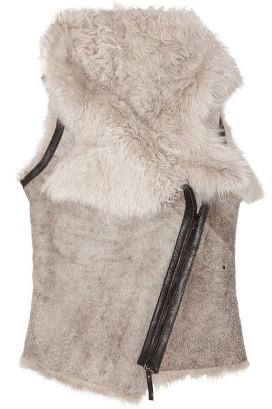 Hand-cut and hand-finished Neutral shearling Asymmetric collar and hem, dark-brown leather trims, paneled seam detail, gunmetal studs at side Asymmetic zip fastening through front 100% shearling (Lamb); trim: 100% leather (Cow) Designer color: Ash