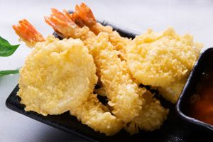 Fun Food Holidays™ January 7th is National Tempura Day _ Tempura is a basic yet popular dish in Japanese cooking. Seafood or vegetables are dipped in a thin batter of flour & water & deep fried in oil. Typical tempura can include shrimp, squid, yams, mushrooms or okra. While you can find tempura in virtually any Japanese restaurant, it's a little known fact that the dish was originally introduced to Japan by Portuguese traders & missionaries!