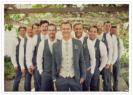 Groomsmen with just vests and groom with full tux