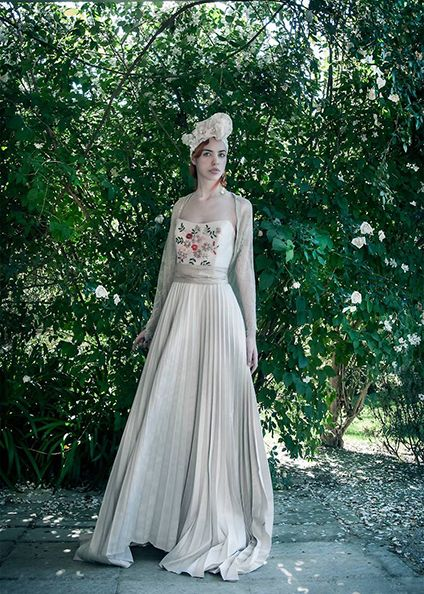 From Elisabetta Delogu Bridal Collection 2017. Silk shantung. Handmade embroideries made with colored ribbons for the bodice. 'Soleil' pleated skirt.