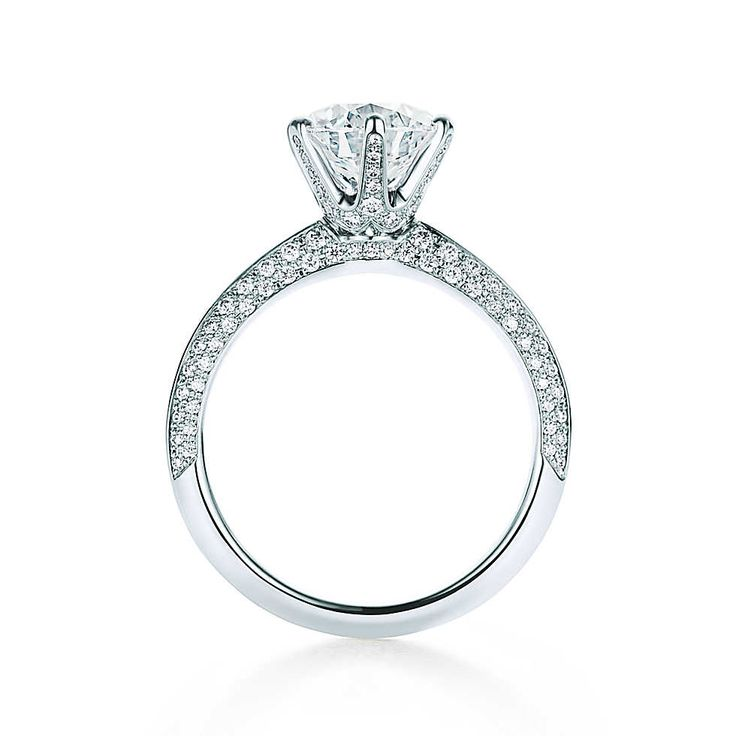 Introduced by Charles Lewis Tiffany 130 years ago, the Tiffany® Setting is the world's most iconic engagement ring. Flawlessly engineered to allow the diamond to float above a six-prong setting, this stunning pavé interpretation—inspired by the extraordinary design featured in the 2016 Blue Book—is a true design masterpiece. The limited anniversary edition ring is available with center stones ranging from 1.5 to more than 6 carats.