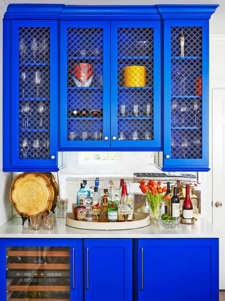 Dazzling cobalt paint and a marble countertop transformed this wet bar into a luxe cocktail station. #hgtvmagazine http://www.hgtv.com/design/decorating/color/12-bold-color-tricks-to-try-in-every-room-pictures?soc=pinterest