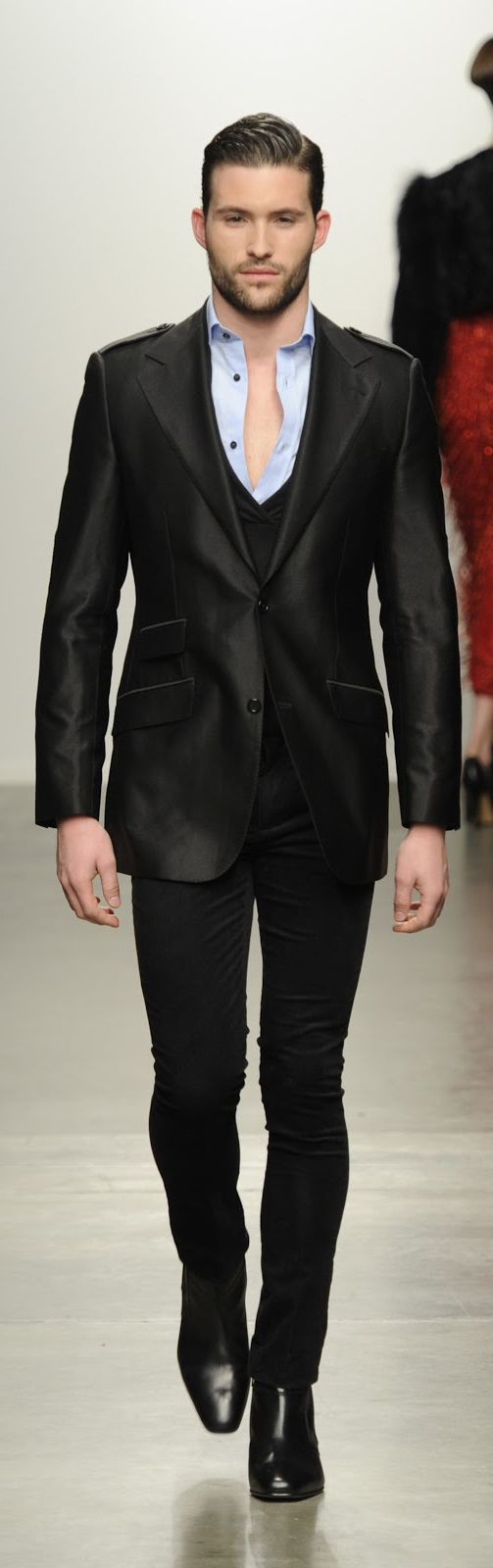 Modern Suit.  Love the slim cut, the pockets, and the sheen.  Absolute perfection.