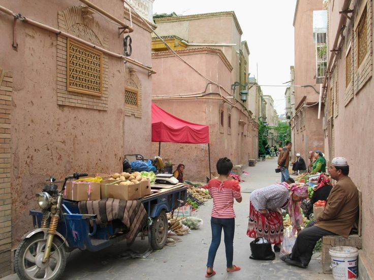 Despite pervasive Chinese influence, local Uyghur life goes on on the back streets of the old town of Kashgar, Xinjiang, China.