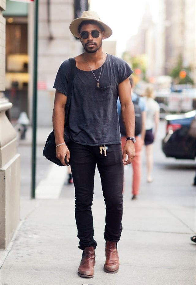 Keys as an accessory.  | Tags: tan hat, fedora, round black sunglasses, scoop neck t-shirt, short sleeves, navy blue, faded, black skinny jeans, brown leather chelsea boots, ball chain necklace, white bracelet, black leather wrist strap, watch, gym bag, weekender, streetsnap outfit
