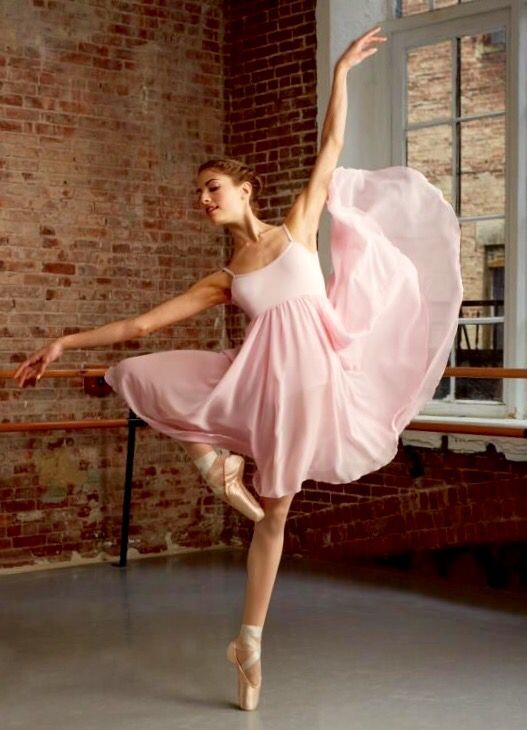 I love how the pointe shoes match with the dress. A truly beautiful shot!