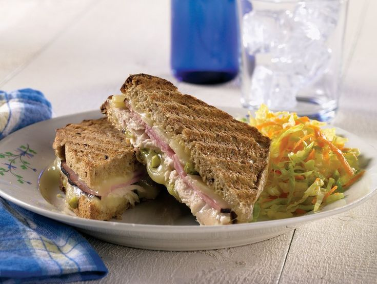 Combine pork, ham, cheese and more to make this delicious Cuban grilled cheese recipe. Get creative with this Cuban grilled cheese sandwich from Cabot!