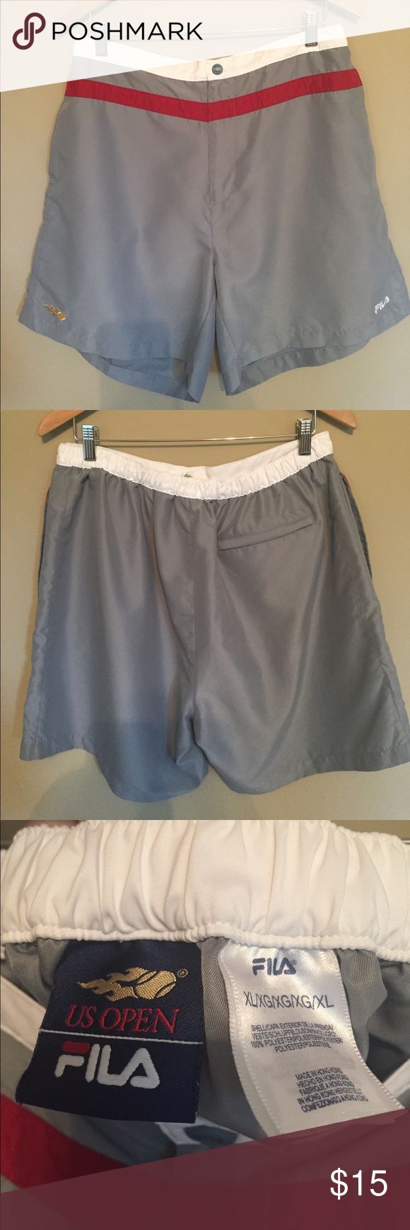 Fila US Open Men's XL tennis shorts Fila US Open Men's XL tennis shorts. Grey with burgundy/red stripe with white waistband. Barely worn! Matching shirt available as well. 🎾 Fila Shorts Athletic