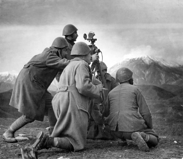 Greek Army soldiers use a rangefinder to target invading enemy Italian positions in the Pindus mountain range during the Greco-Italian War. The initial Greek counteroffensive was the first successful land campaign against the Axis Powers during the war, forcing Germany to attack Greece to save the Italians in April 1941. Pindus mountain range, Epirus Region, Greece. November 1940.