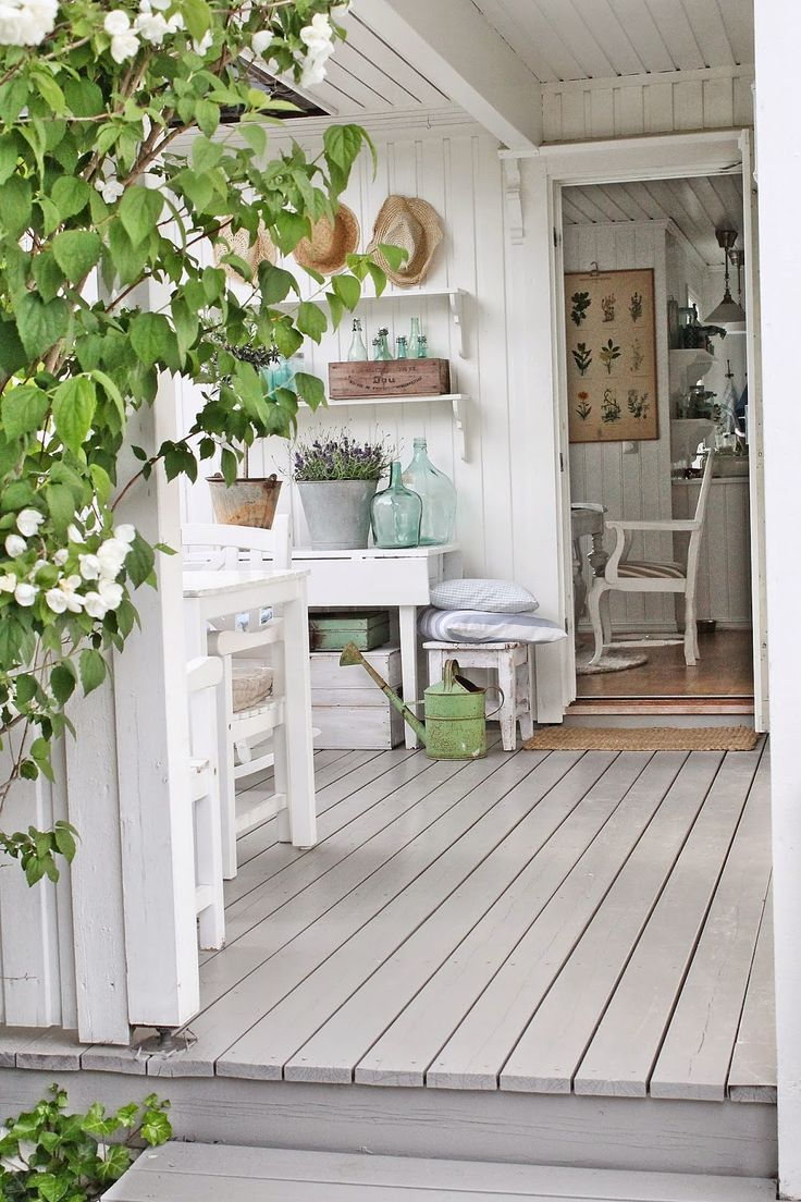 Wood floors and walls and white furniture. But all the pretty vintage accents make it warm and welcoming. Love that table with the foldable top.
