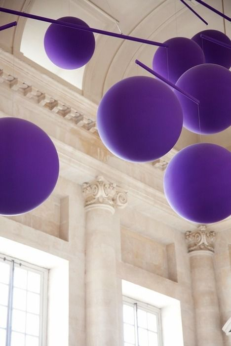 <3 <3 ADD diy www.customweddingprintables.com ... purple balloons suspended on string from purple wood dowels!