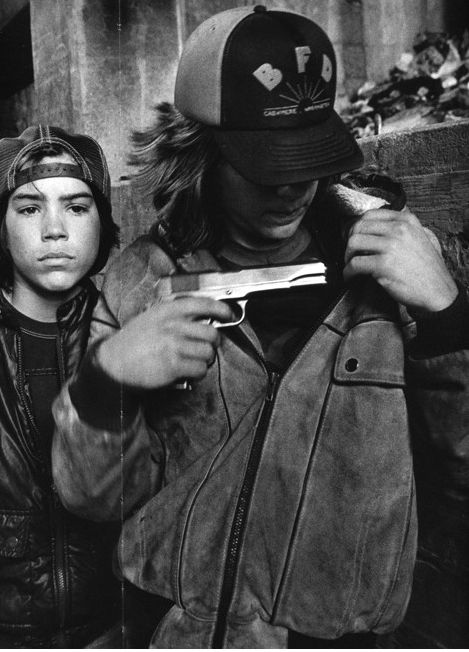 """""""Rat"""" and Mike with a gun, homeless kids Seattle, Washington, 1983 Mary Ellen Mark - ( Streetwise documentary )"""