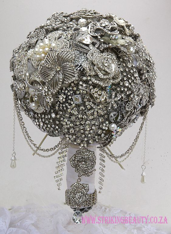 Exquisite silver Brooch Bouquet with trailing accents - the one item from your wedding day to cherish, keep and display for ever .together with your photos.  To order contact Susan www.strikingbeauty.co.za or email susanvz@klr.co.za