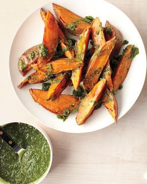 When roasting sweet potatoes, leave the skins on for greater nutrition (and better texture). High heat muddies the fresh flavors of the herbs and lemon zest in pesto, so spoon it on just before serving.