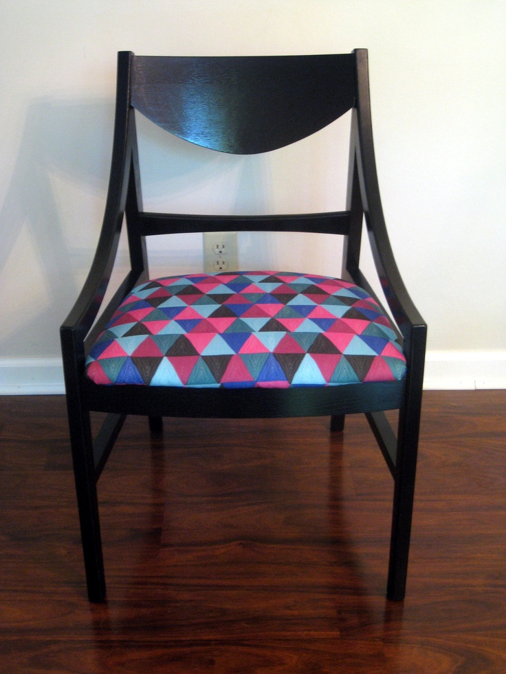 Pair of mid century modern chairs. Black wood with geometric seats. From gremaggy, via Etsy.