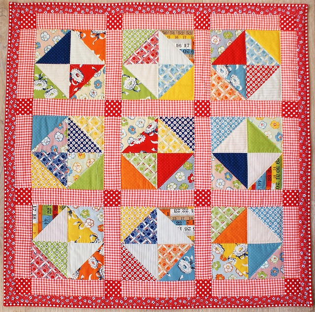 Cute scrappy quilt  Boy or girl depending on the colors of the inner and outer borders and setting squares.