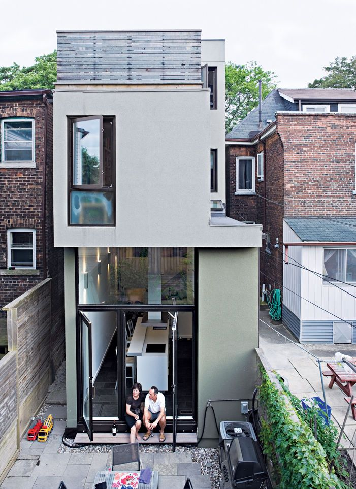 A rear view of the narrow house shows how Chong twisted the house's volumes to bring daylight into each room.
