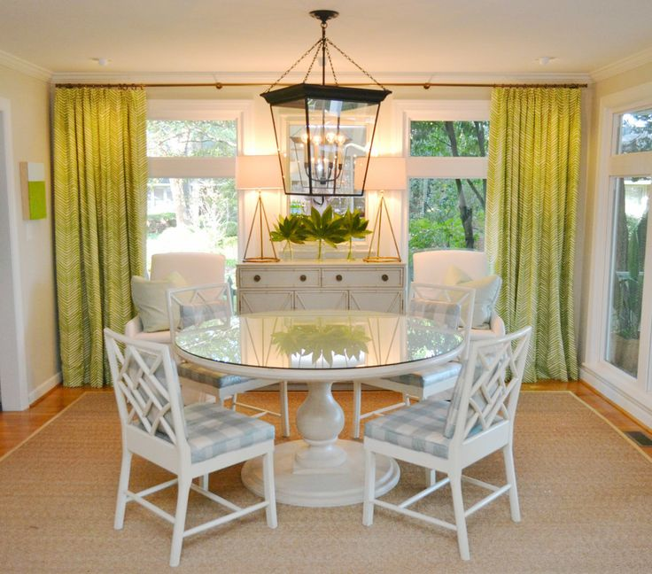 the curtains and the chairs add a real tropical feel to this room
