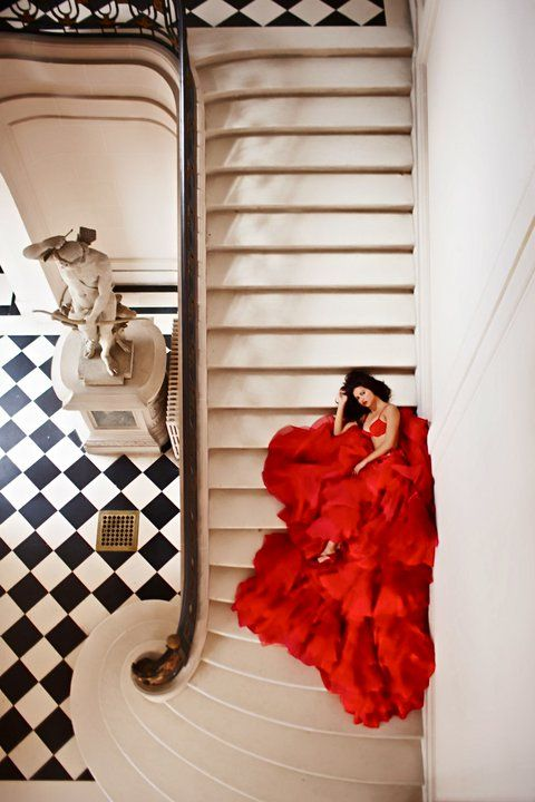Adriana Lima I repinned this from my photography board because it is so striking. How many staircases have you see like this? Then you got to get a gorgeous dame in a gorgeous red dress,,, sigh!