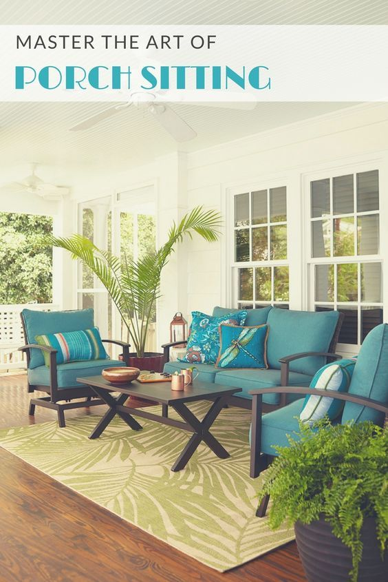 Revive the lost pastime of lounging on the porch. Farmhouse style tables and rustic chairs are topped with pool blue cushions designed for lazy days. A classic white porch fan and palm décor keep things cool in every way.