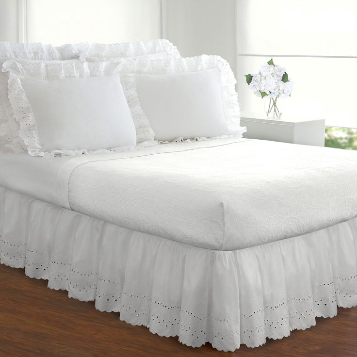 Give your bed a romantic makeover with this stylish ruffled heirloom bed skirt. This cotton bed skirt has an alluring eyelet pattern that lends country charm to your bedroom and is available in two colors to match your existing bedding.