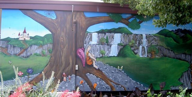 Give your kids a magical pixieland to play in. #kids #play #fairy #magic #aerosolart #forthehome #backyard