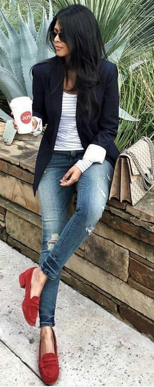 Blue jeans black blazer red shoes