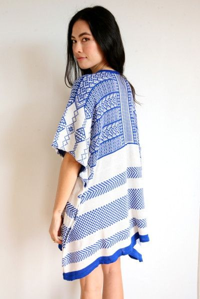 Details include wide cut sleeves, open drape front, and a relaxed fit. The unique pattern and flattering cut of this knit drape makes it the perfect statement piece, while its super soft knit keeps yo