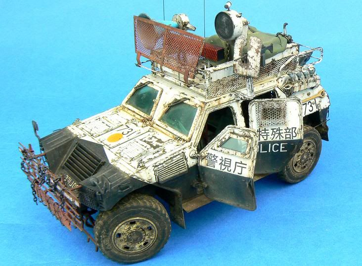 """Apocalyptic Japanese Police Car "" TAMIYA 1/35 scale JGSDF Light armored vehicle. By Jamie 'Haggis' Haggo. ""警視庁特殊部隊"" The Japanese writing says ""Tokyo Metropolitan Police Department Special Assault Team"" #model_cars #scale_model"