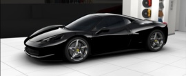 """The 458 Italia is a synthesis of style, creative flair, passion and cutting-edge technology, characteristics for which Italy as a nation is well-known."""" This one is custom designed with black exterior, graphite and black leather interior, and a matching suit bag."""