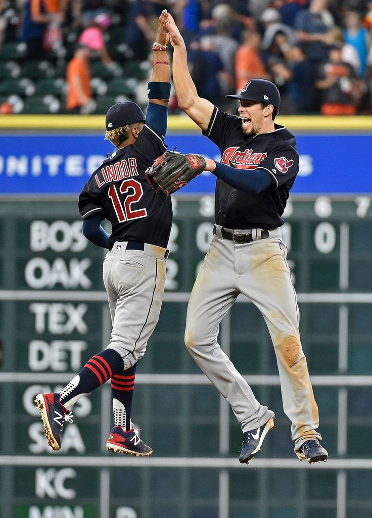 Cleveland Indians' Francisco Lindor (12) and Bradley Zimmer (4) celebrate the team's 3-0 win over the Houston Astros, Saturday, May 20, 2017, in Houston. (AP Photo/Eric Christian Smith)