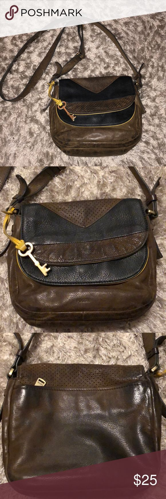 Fossil Cross Body Purse This purse has definitely been put to good use. Ya perfect for a going out bag. The leather has faded which happens with genuine leather. The inside has makeup stains, price reflects this wear. Some life left to it! Fossil Bags Crossbody Bags