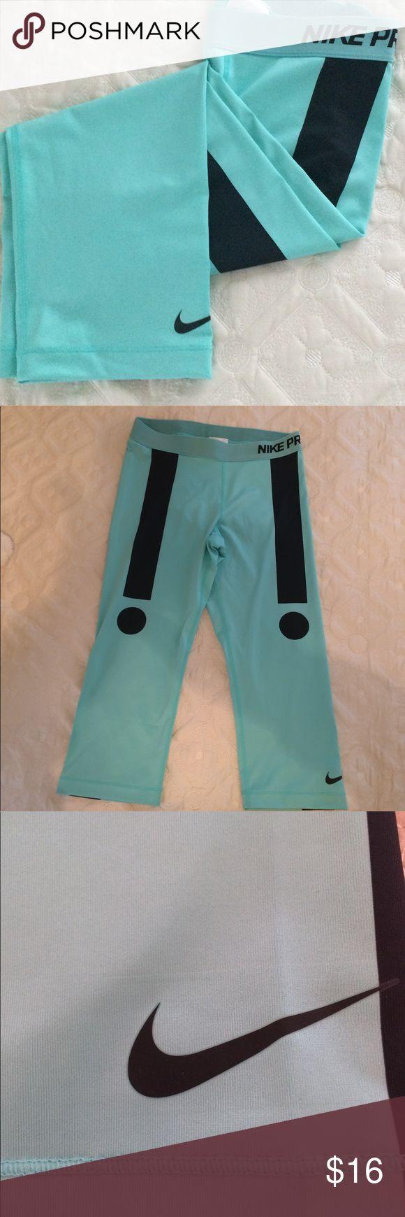 Nike Pro Capri workout pants size Large Nike Pro NWOT! Capri workout pants. Make a statement in these teal and black Nike Pro pants. Take your workout to the next level. Size Large Nike Pants