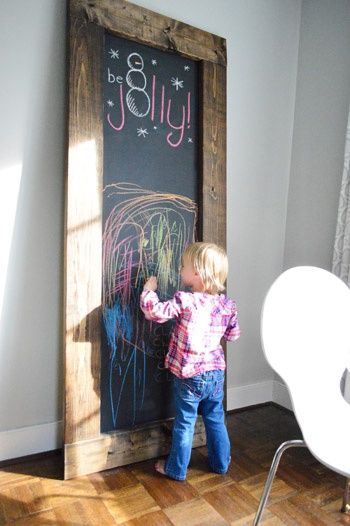 Decorate with a large, framed chalkboard (homemade or purchased) in your child's room. You can write a different scripture or quote at the top everyday, and let her draw on the bottom half.