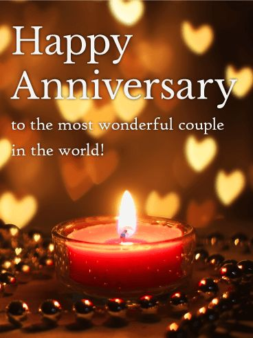 To the World's Most Wonderful Couple! - Happy Anniversary Card: Do you know a wonderful couple celebrating their anniversary? Let them know you believe in their love and wish them a happy anniversary now. Sending an anniversary card is a simple and wonderful way to share thoughtful and heartfelt wishes. This anniversary card has warm candlelight with little hearts of light floating in the background for a very warm and intimate greeting that is sure to draw their smile.