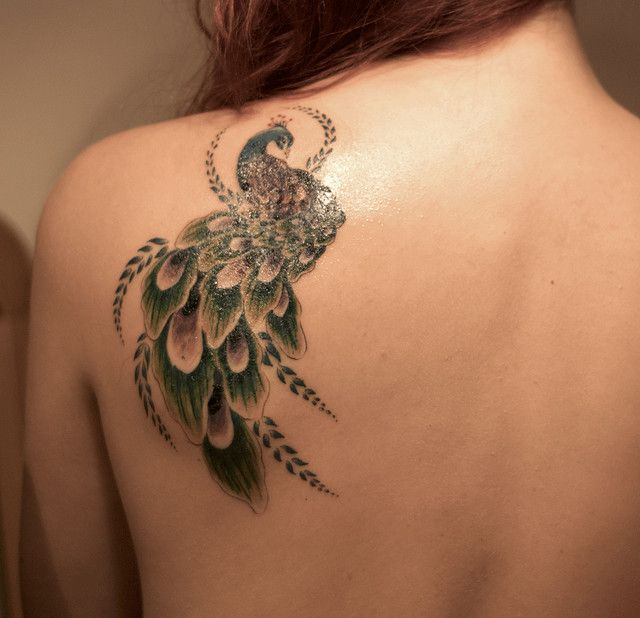 Oh god. This makes me sad because I wish THIS were the peacock tattoo I had (it's even the same place mine is). Sigh.