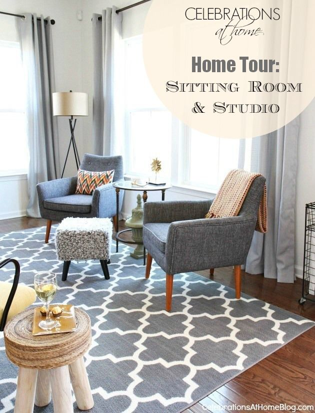 This rug was at Tuesday Morning!  (love the gray curtains and gray chairs with rug - white walls!