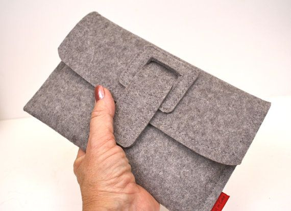Simple yet functional case to protect your Kindle is created from a thick, sturdy felt. Front strap is secured with velcro.
