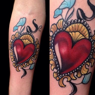 Tattoo artist Giulia Bongiovanni created this incredible tattoo with that deep red heart and gorgeous yellow framing.