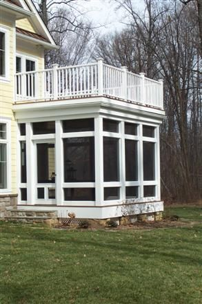 home addition: screened in porch with balcony on top.