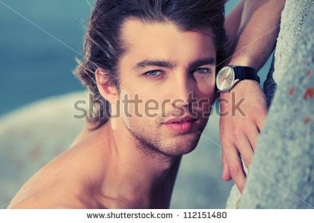 Portrait of a handsome male model posing at the seaside.