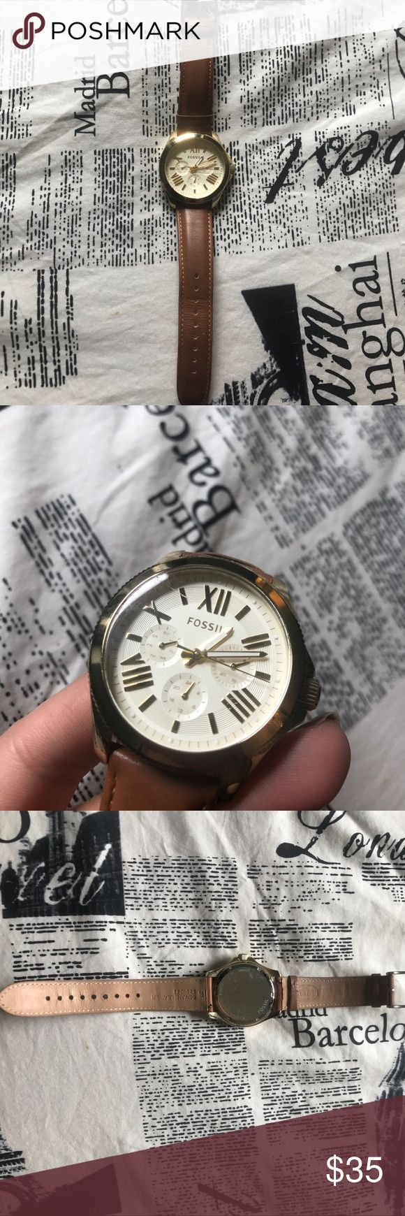 Gold Face Fossil Watch w/ Brown Leather Band Gently used genuine Fossil watch. Battery is dead, but Fossil will replace for $10 and price reflects the dead battery. The face has one scratch in the top left corner reflected in the second picture. Fossil Accessories Watches