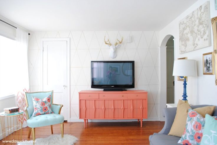 i can't even. From the coral TV stand DIY, to the DIY ikat curtains, and can we just say mint+gold+coral (maaaaay be my wedding colors one day)... i'm obsessed.