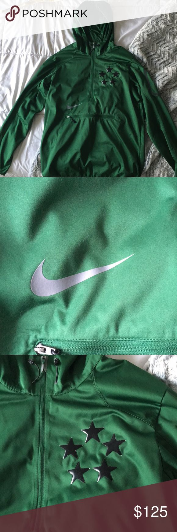 Nike half zip men's football jacket My brother's Nike jacket with a front belly pocket (kangaroo pouch style) and half zip. It's a beautiful emerald green color and still in great condition! Small football logo on the hood as included in the pictures and drawstring adjusting bottom and hood. A pocket on the left arm perfect for a phone. This jacket is NOT waterproof. Nike Jackets & Coats Windbreakers