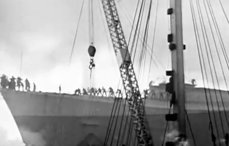 Workman escaping from the SS N ormandie as it burns.