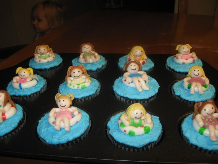 Cupcakes made to go with the swimming pool cake.  The figures were made with fondant.  I tried to make each child look like the kids that were going to be at the party.  They were a big hit!