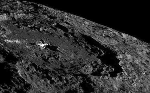 New Image of Ceres from NASA's Dawn Spacecraft  NASA's Dawn Spacecraft views the shadowy, cratered terrain of Ceres in a dramatic new view of the dwarf planet. Dawn snapped this image on October 16, from its fifth science orbit, in which the angle of the sun was different from that in previous orbits. Dawn was about 920 miles (1,480 kilometers) above Ceres when […]  The post  New Image of Ceres from NASA's Dawn Spacecraft  appeared first on  SciTech Daily .  http://scitechdaily.co..