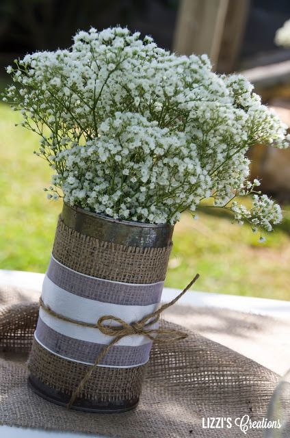 Baby's breath in an aged aluminum can with burlap, lace and jute twine... make simple and cheap, but elegant wedding decor