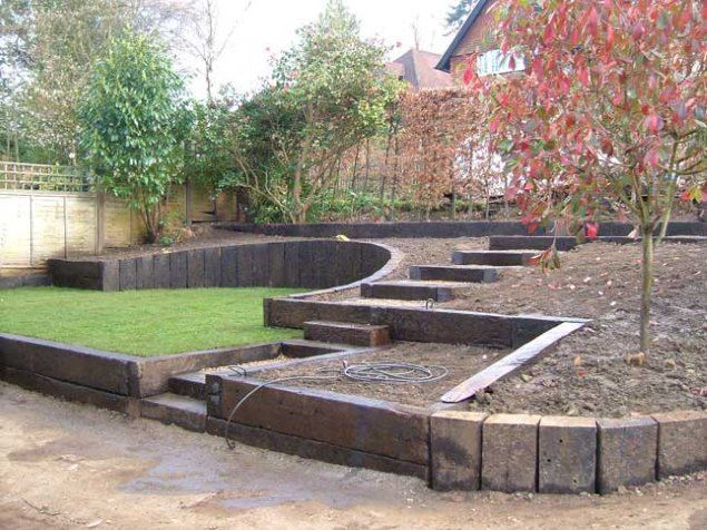 The use of oak sleepers for arrangement of the courtyard and garden   A private house